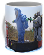 An Airman Stands In A Tub Of Cleaning Coffee Mug by Stocktrek Images