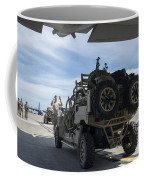An All-terrain Vehicle Is Guided Onto Coffee Mug