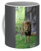 An Amazing Look At A Prowling Lion Standing In Grass Coffee Mug