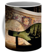An Antique Map Provides The Backdrop Coffee Mug