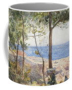 An Artist Painting By The Sea Coffee Mug