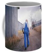 An Elderly Farmer In Overalls Walks Coffee Mug