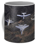 An F-16 Fighting Falcon, F-15 Eagle Coffee Mug by Stocktrek Images