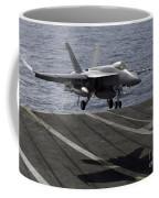 An Fa-18e Super Hornet Prepares To Land Coffee Mug by Stocktrek Images