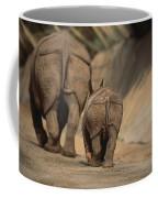An Indian Rhinoceros And Her Baby Coffee Mug by Michael Nichols