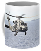 An Mh-60r Seahawk Helicopter In Flight Coffee Mug