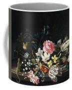 An Overturned Vase Of Flowers Resting On A Ledge Coffee Mug