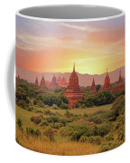 Ancient Pagodas In The Countryside From Bagan In Myanmar At Suns Coffee Mug