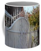 Angled Closeup Of White Washed Iron Gate To Garden Coffee Mug