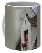 Animal Statue On The Dormer Roof Of A House In Bruges Belgium Coffee Mug