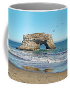 Arch In The Sea With Pelicans Flying By, At Natural Bridges State Beach, Santa Cruz, California Coffee Mug