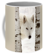 Arctic Wolf Seen Between Two Trees In Winter Coffee Mug