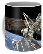 Astronauts Perform A Series Of Tasks Coffee Mug by Stocktrek Images
