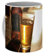 Backlit Glass Of Beer And Empty Bottle On Table Coffee Mug