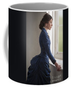 Beautiful Victorian Woman At The Window In A Blue Bussle Dress Coffee Mug