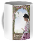 Beautiful Victorian Woman In Pink Dress Standing Under A Wisteri Coffee Mug