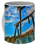 Bench On The River Coffee Mug