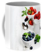 Berries In Bowls  On Wooden Background. Coffee Mug