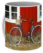 Bicycle In Front Of Red House In Sweden Coffee Mug