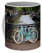 Bicycle Parked At The Bridge In Amsterdam. Netherlands. Europe Coffee Mug