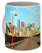 Biking On The Stone Arch Bridge Coffee Mug