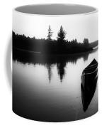 Black And White Canoe In Still Water Coffee Mug