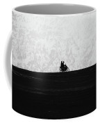 Black And White Capture Of Two People Riding On The Motorbike In The Distance Coffee Mug