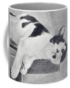Black And White Cat Lounging Coffee Mug