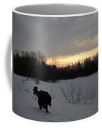 Black Dog Exploring Snow At Dawn Coffee Mug