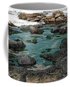 Black Rocks On Blue Water Coffee Mug