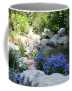 Blue Flowers And Stream Coffee Mug by Corey Ford