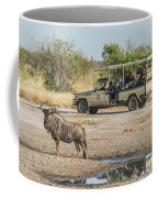Blue Wildebeest Beside Puddle With Jeep Behind Coffee Mug