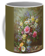 Bluebells Daffodils Primroses And Peonies In A Blue Vase Coffee Mug