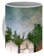 Boathouses With Sky And Trees Coffee Mug by Michelle Calkins