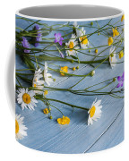 Bouquet Of Wild Flowers On A Wooden Coffee Mug
