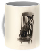 Boxer Sitting On A Chair Coffee Mug