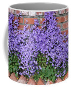 Brick Wall With Blue Flowers Coffee Mug