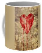 Broken And Bleeding Heart On The Wall Coffee Mug
