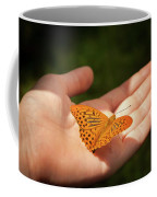 Butterfly On A Childs Hand Coffee Mug