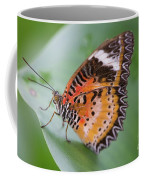 Butterfly On The Edge Of Leaf Coffee Mug by John Wadleigh