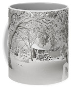 Cabin In Snow By The Sea Coffee Mug