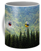 Cable Car Passes By A Mountain Slope Coffee Mug