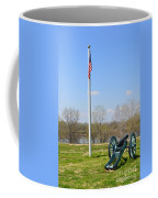 Cannon And Flagpole Overlooking River Coffee Mug