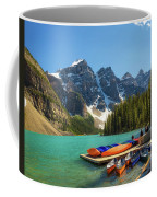 Canoes On A Jetty At  Moraine Lake In Banff National Park, Canada Coffee Mug