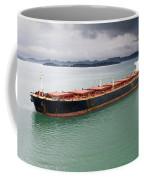 Cargo Ship Under Stormy Sky Coffee Mug