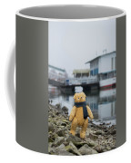 Cheerful Teddy Bear In Knitted Scarf Stand By The Riverside Beside The Port Coffee Mug