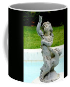 Child On Swan Coffee Mug