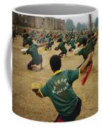 Children Practice Kung Fu In A Field Coffee Mug by Justin Guariglia