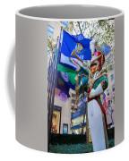 Christmas Trumpeter At The Rock Coffee Mug