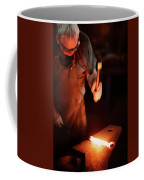Close-up Of  Blacksmith Forging Hot Iron Coffee Mug